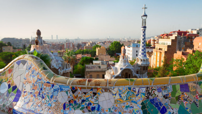 46968013 - gaudi bench and cityscape of barcelona  from park guell,  spain